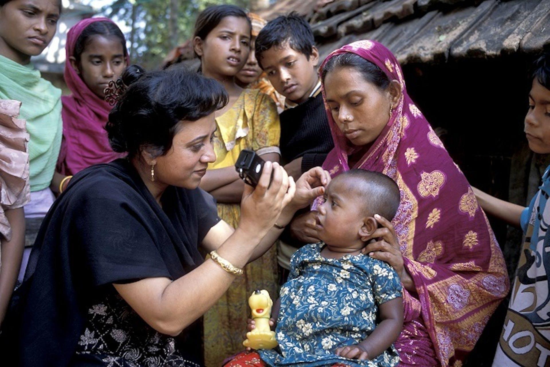 Bangladeshi paediatric patient Afioza Yazim gets an eye examination