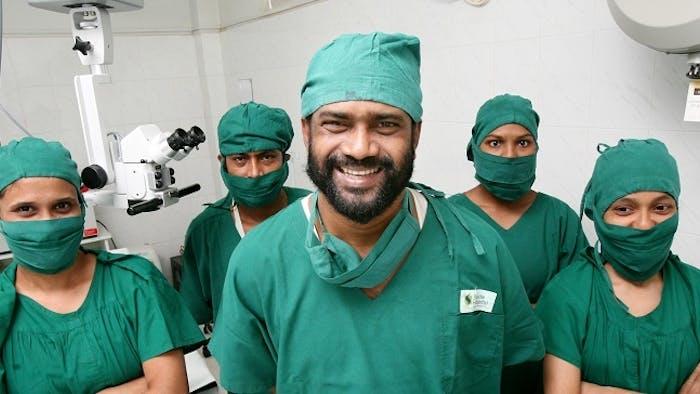 Smiling doctors and nurses in green scrubs at the Sajida Foundation in Bangladesh