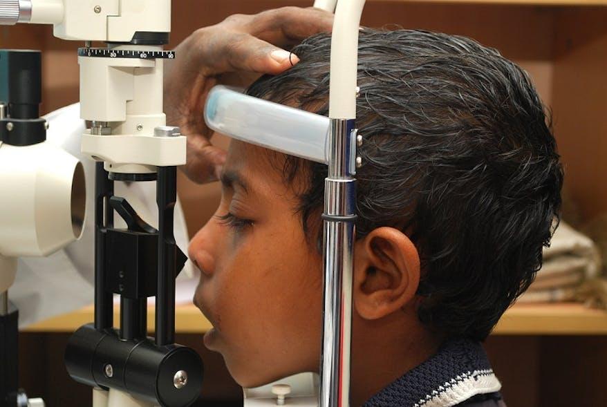 A young boy has an eye test in Islamia Eye Institute