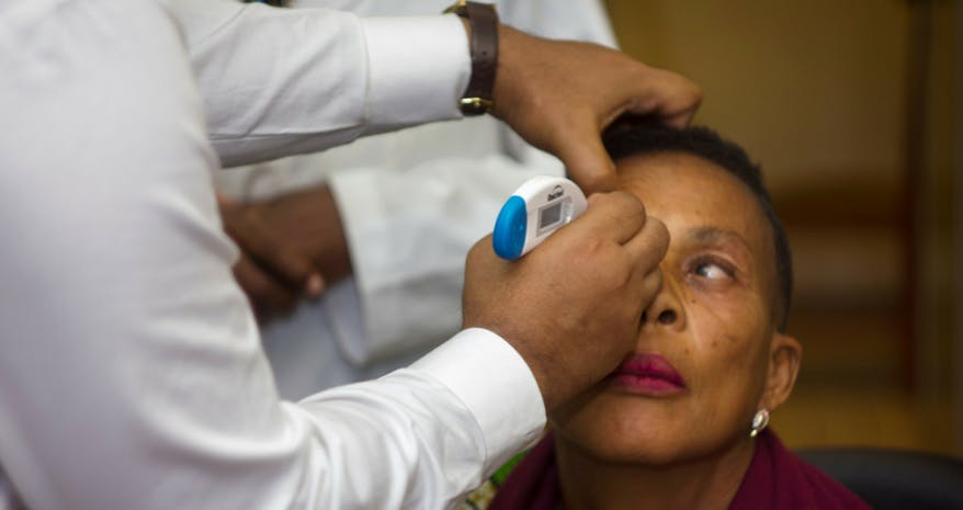 Cameroon patient Honorine being screened for cataract