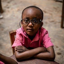 Child in glasses.