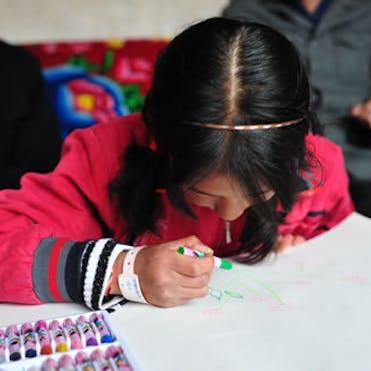 Young girl writing.