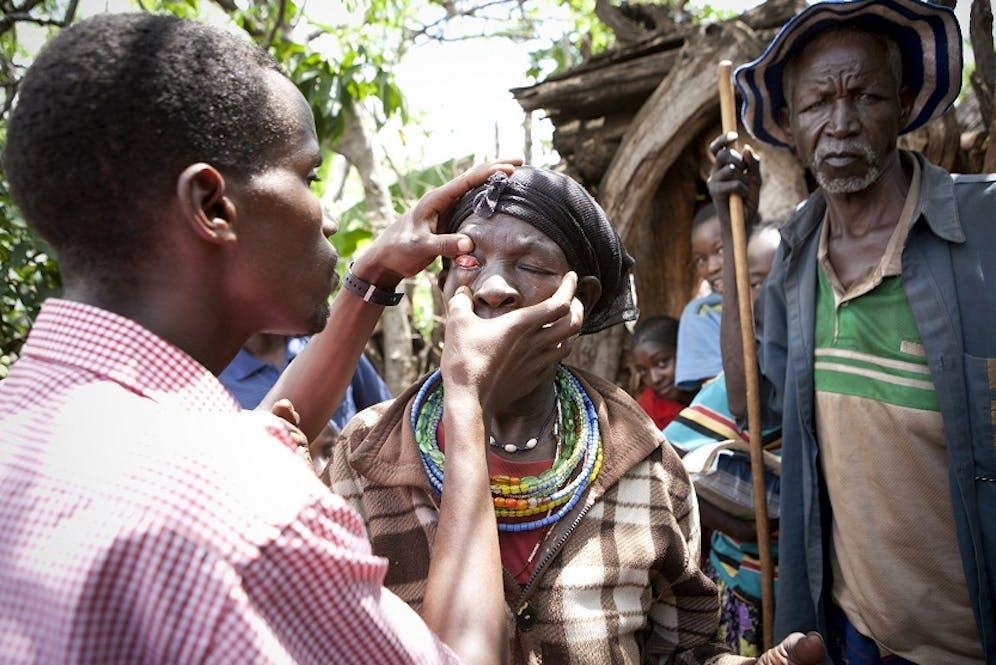 Ethiopian woman receives eye exam.