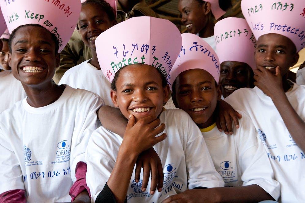 Smiling children promoting trachoma prevention.