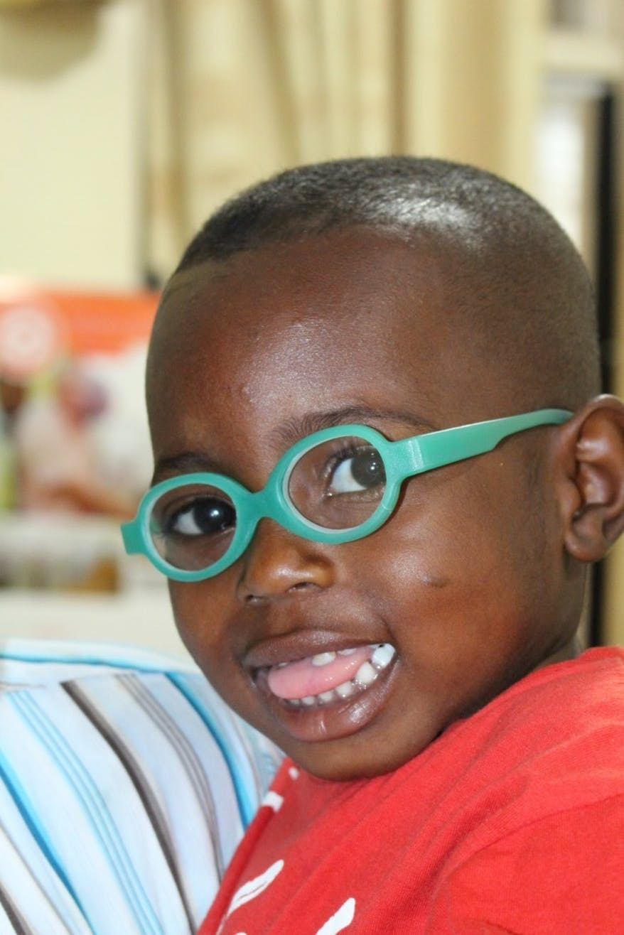 Ghanian child wearing glasses.