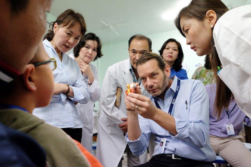 Dr Daniel Neeley screening a young patient.