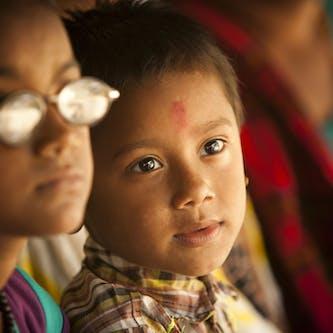 Nepalese paediatric patient Krish awaits an eye exam