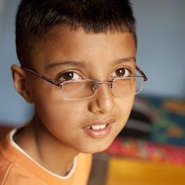 Child wearing glasses.