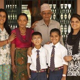 Family outside eye treatment centre.
