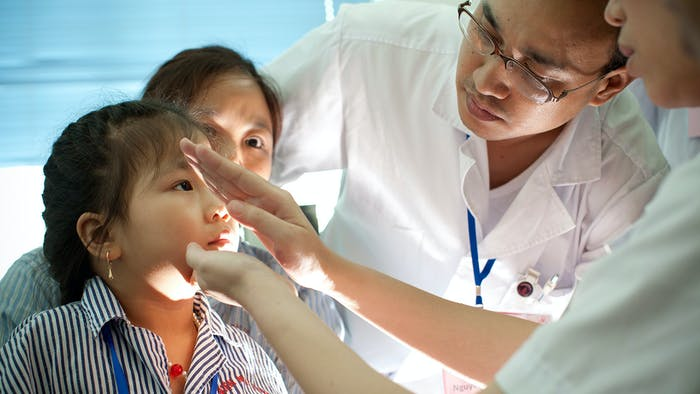 An eye examination on a young patient in Peru
