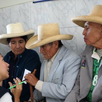 A line of men wearing hats in Peru