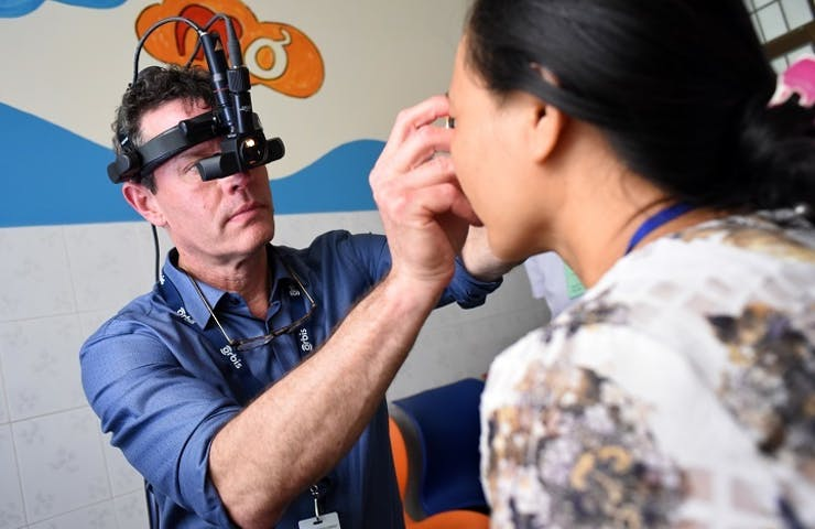 A Vietnamese woman in Binh Dinh is given an eye examination by a volunteer surgeon