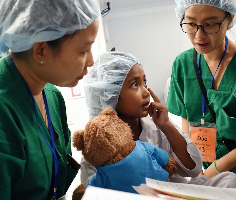 Vietnamese paediatric patient Dieu talking to doctors