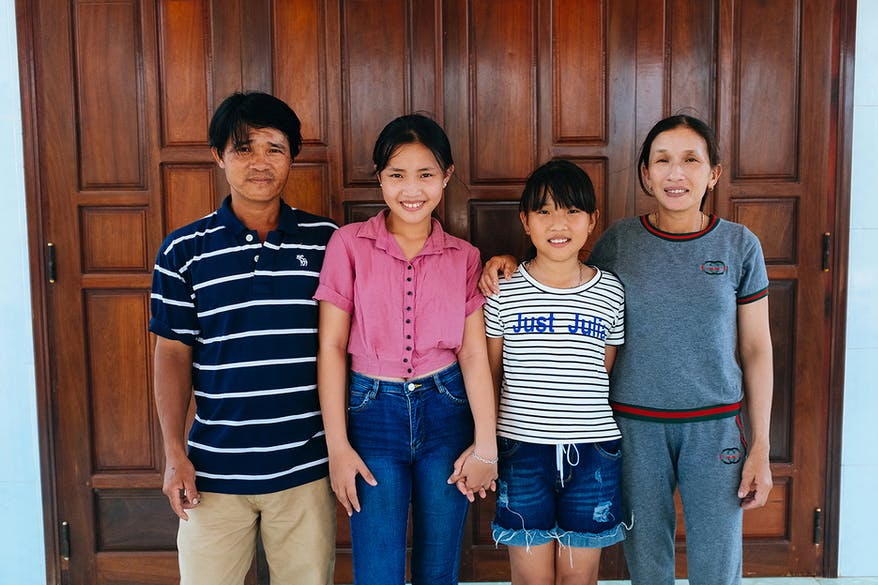 Strabismus patient Trinh with her family, Vietnam