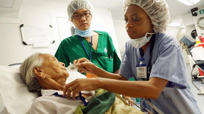 Volunteer nurse Angeline Chaipa with a Vietnamese patient