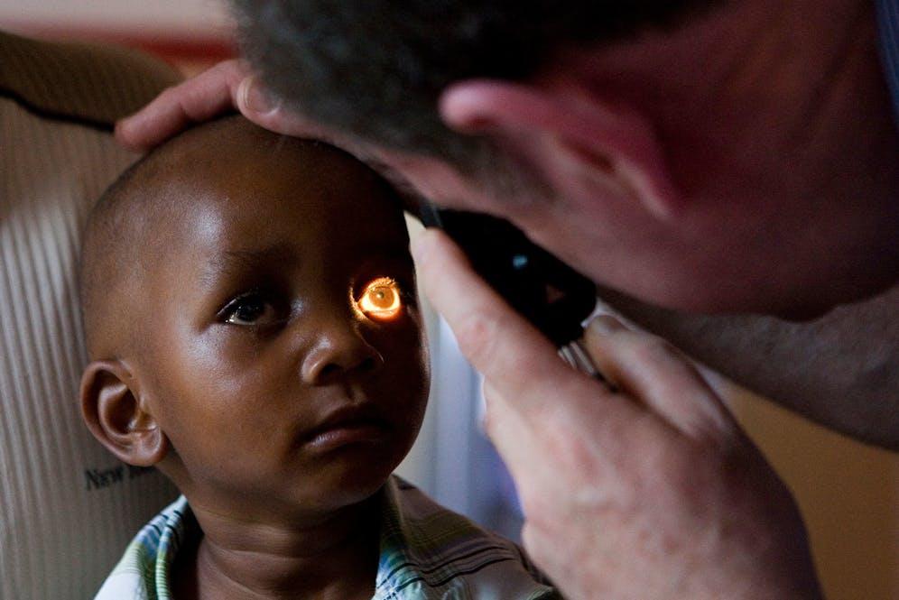 A child receiving eye treatment in Zambia