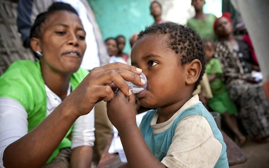 Young patient receives Zithromax antibiotics in Ethiopia