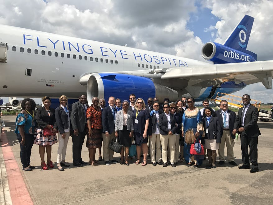 Generous Orbis supporters stand outside the Flying Eye Hospital