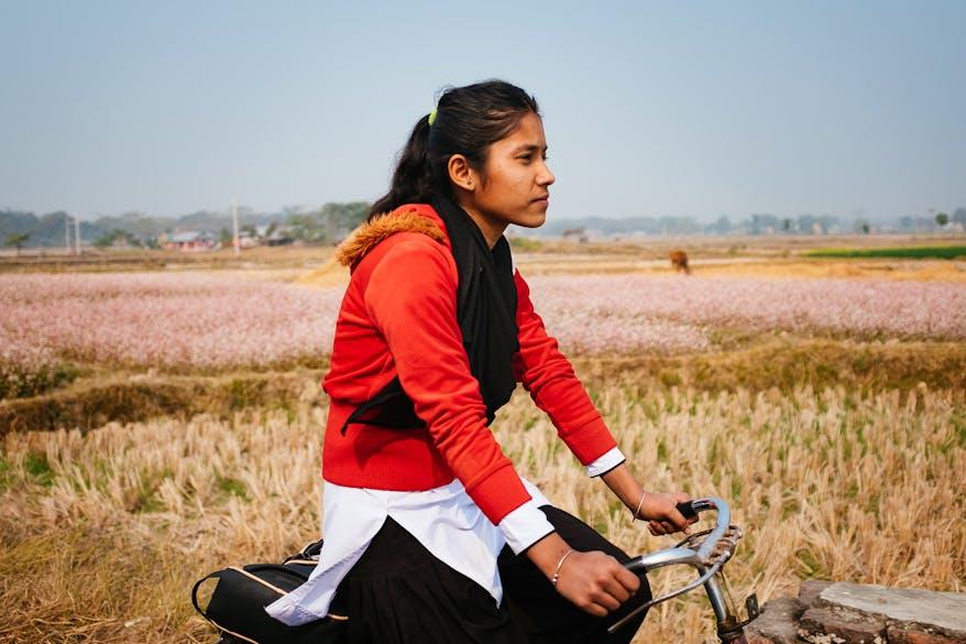 Bitisha from Nepal rides her bike home