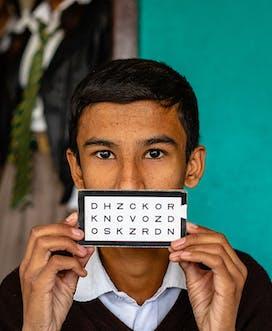 Boy With Tablet Nepal School Screening