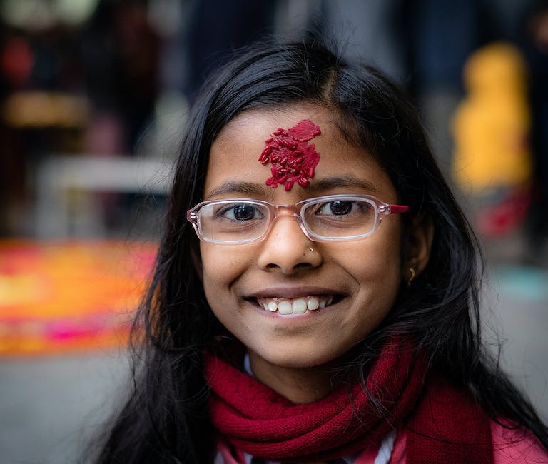 Megha smiling for the camera after her teacher referred her for an eye screening