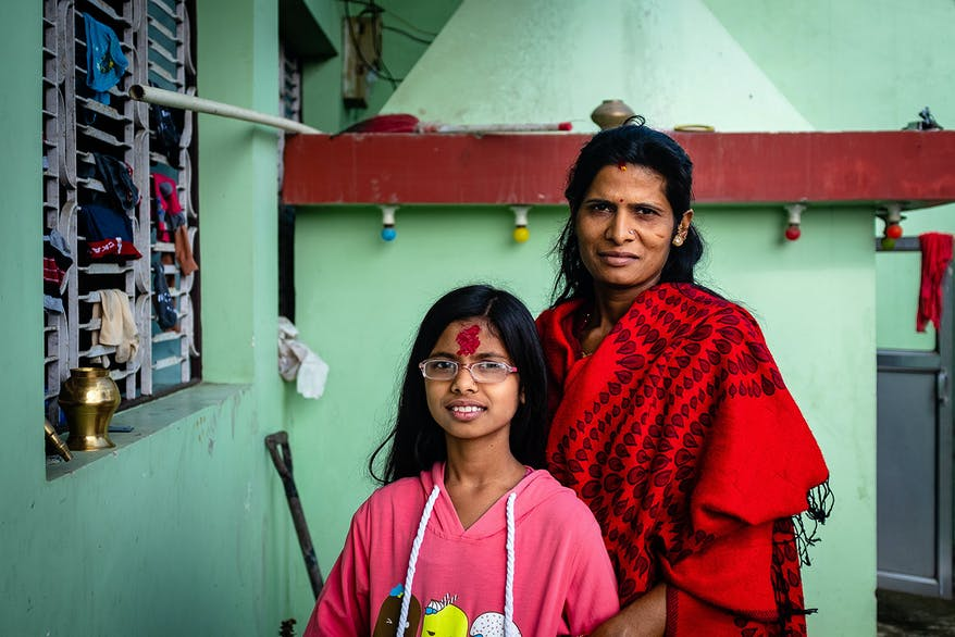 Orbis End of Year Appeal: Megha pictured with her mom and her new glasses which have helped her poor vision