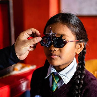 A child undergoes screening in a Nepalese classroom