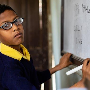 Shashant from Nepal writes on the whiteboard