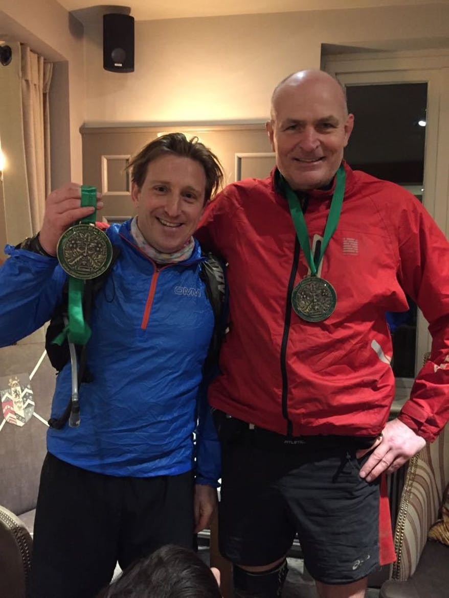 Ian Wilkinson and Greg Hingley after the Green Man Ultra, brandishing their medals