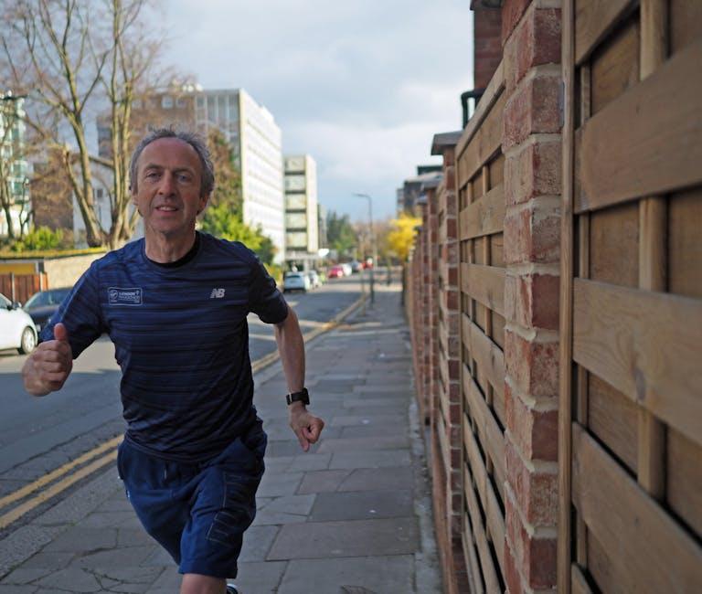 Supporter James Buchanan running down the street while marathon training