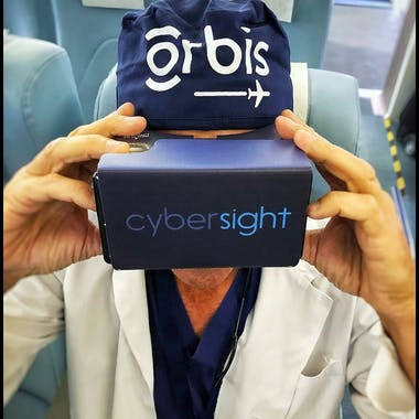 Dr. Daniel Neely using VR goggles for eye health training