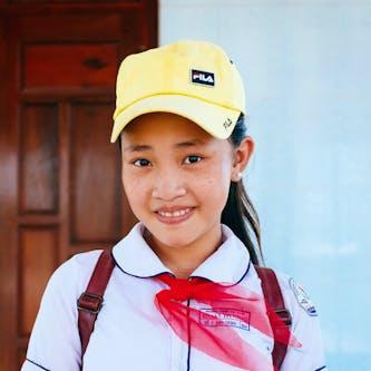 Trinh from Vietnam pictured in her school attire