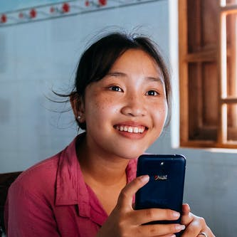 Trinh sat in her house following a successful operation to correct strabismus