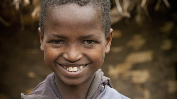 Bright eyed smiling young man.