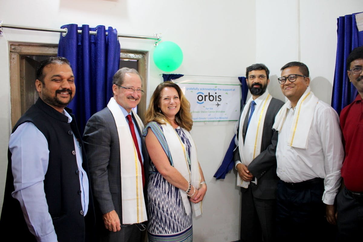 Orbis CEO unveiling the Green Vision Center plaque