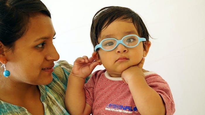 Child wears new glasses.