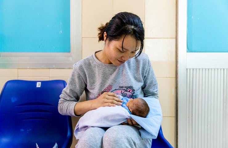 A mother and her premature baby waiting for a retinopathy of prematurity screening at Binh Dinh hospital in Vietnam