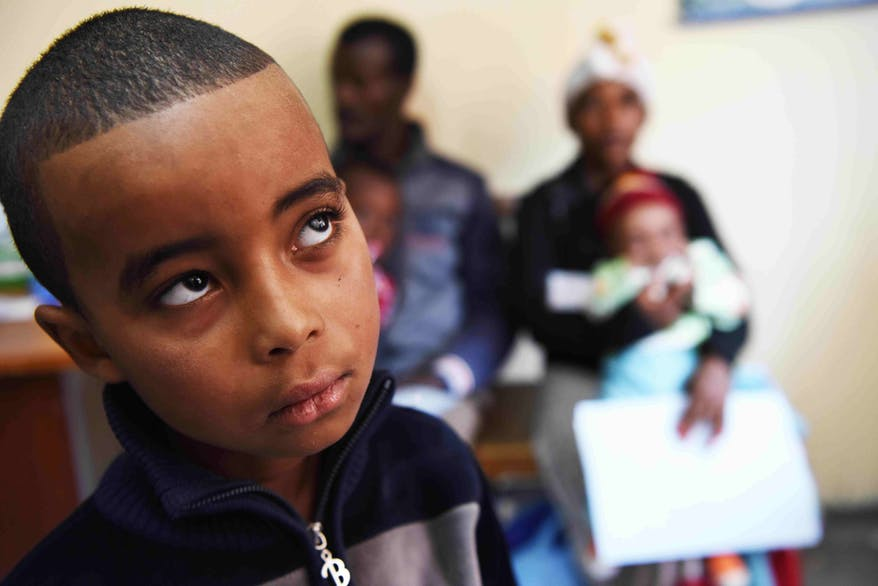 A young boy with strabismus waits to be screened in Addis Ababa, Ethiopia