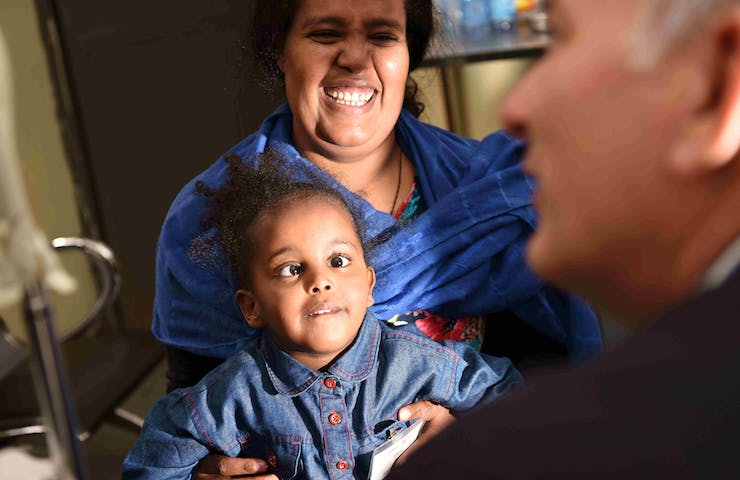 A child with strabismus is examined by an Orbis Volunteer Faculty surgeon in Ethiopia