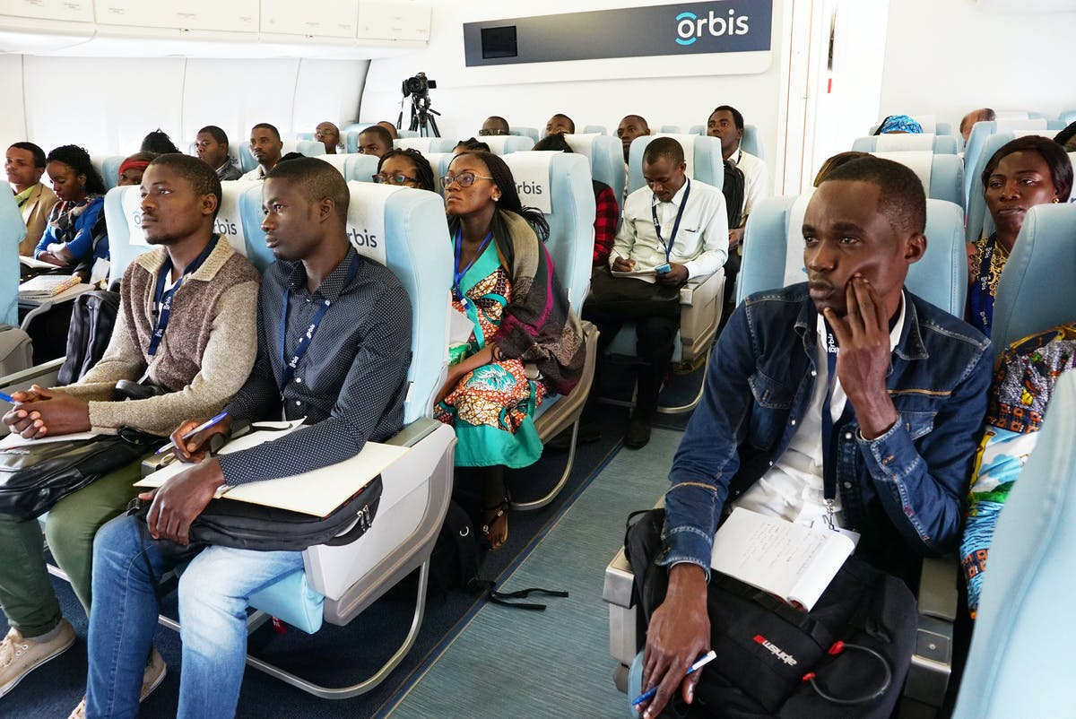 The team seated on the flying eye hospital.