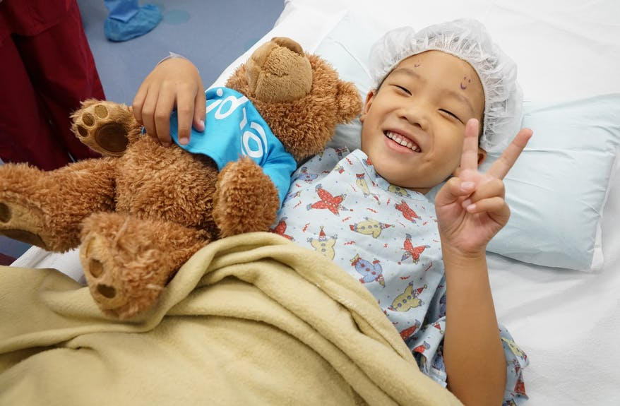 Zhang Yu Gao, age 5, waited for strabismus surgery on the Flying Eye Hospital