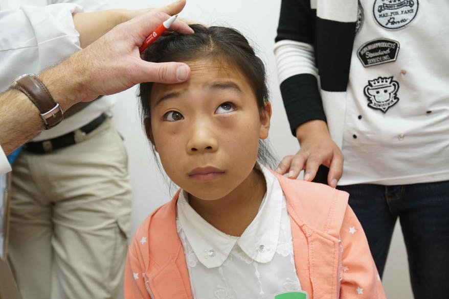 Young patient Hong is screened by Volunteer Faculty in Shenyang, China, 2016