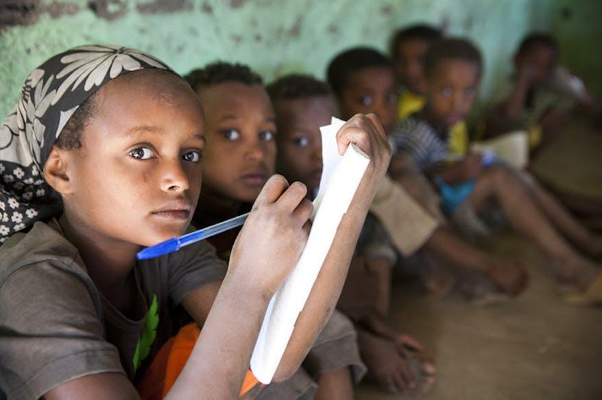 Ethiopian children write on a piece of paper