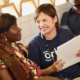 Orbis Communications Manager Celia Yeung meets a patient in Cameroon