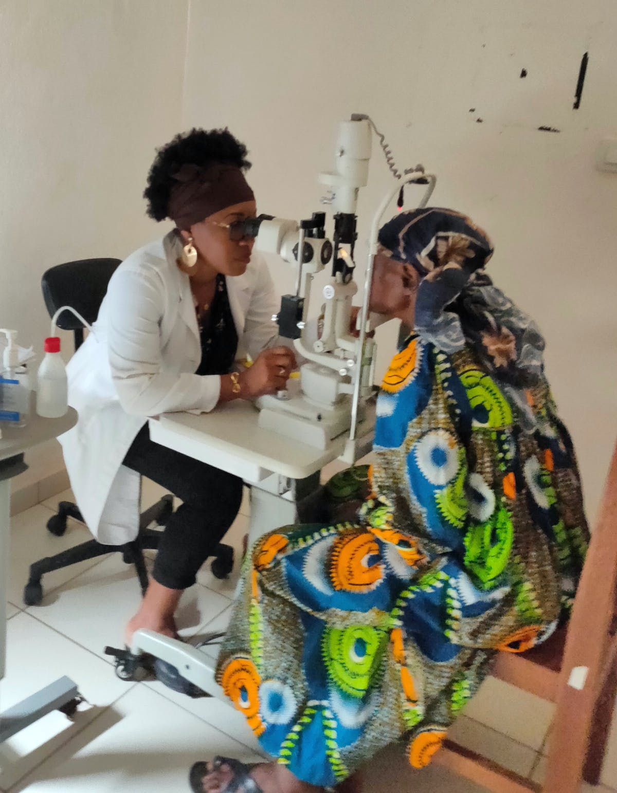 Dr Danielle Beleho is an ophthalmologist in Yaoundé, Cameroon - here she is pictured carrying out an eye examination