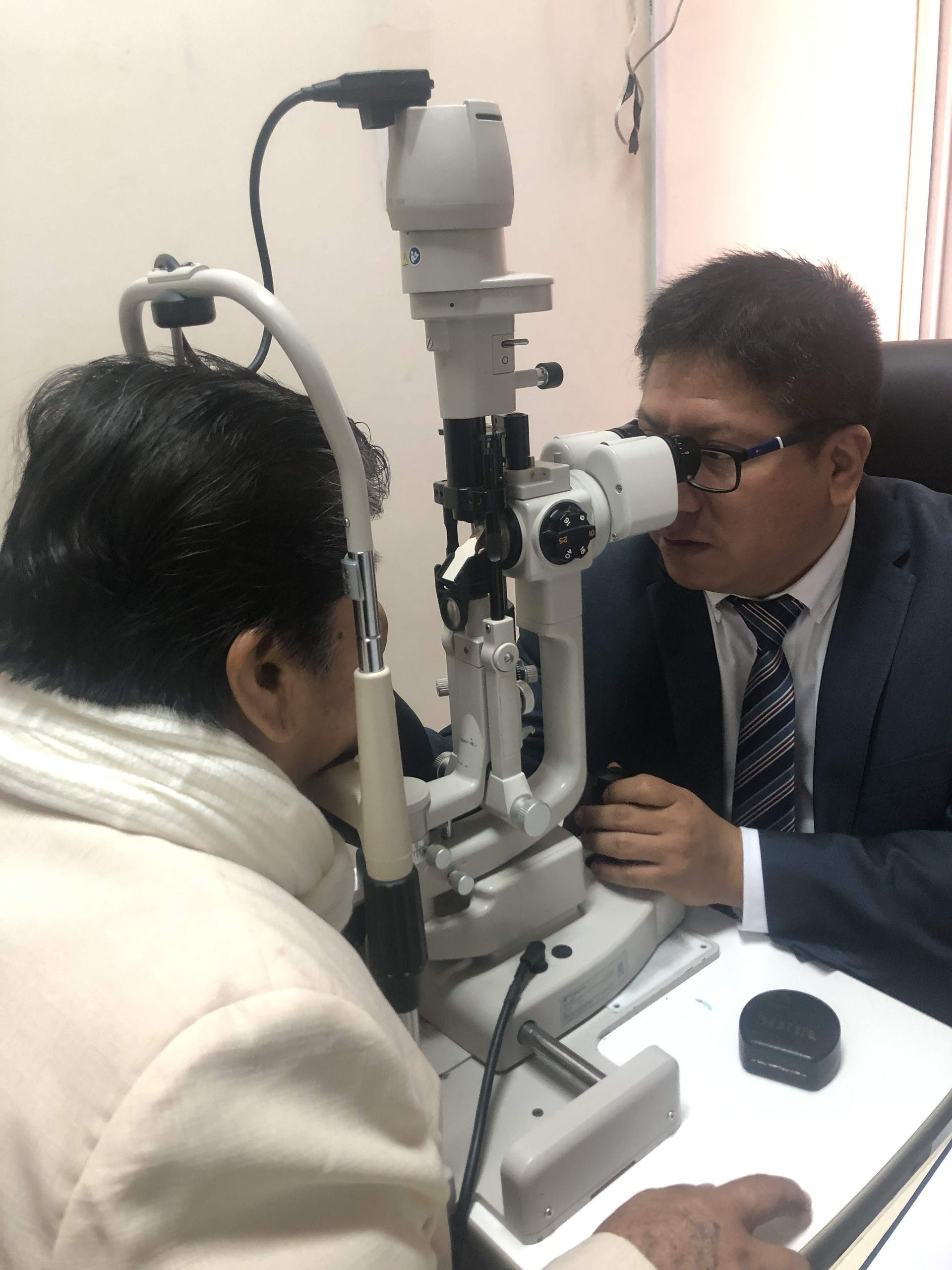 Orbis trainee Dr. De La Cruz screening patient 69-year-old Maria post-cataract surgery