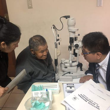 Screening a cataract patient in Peru post-surgery