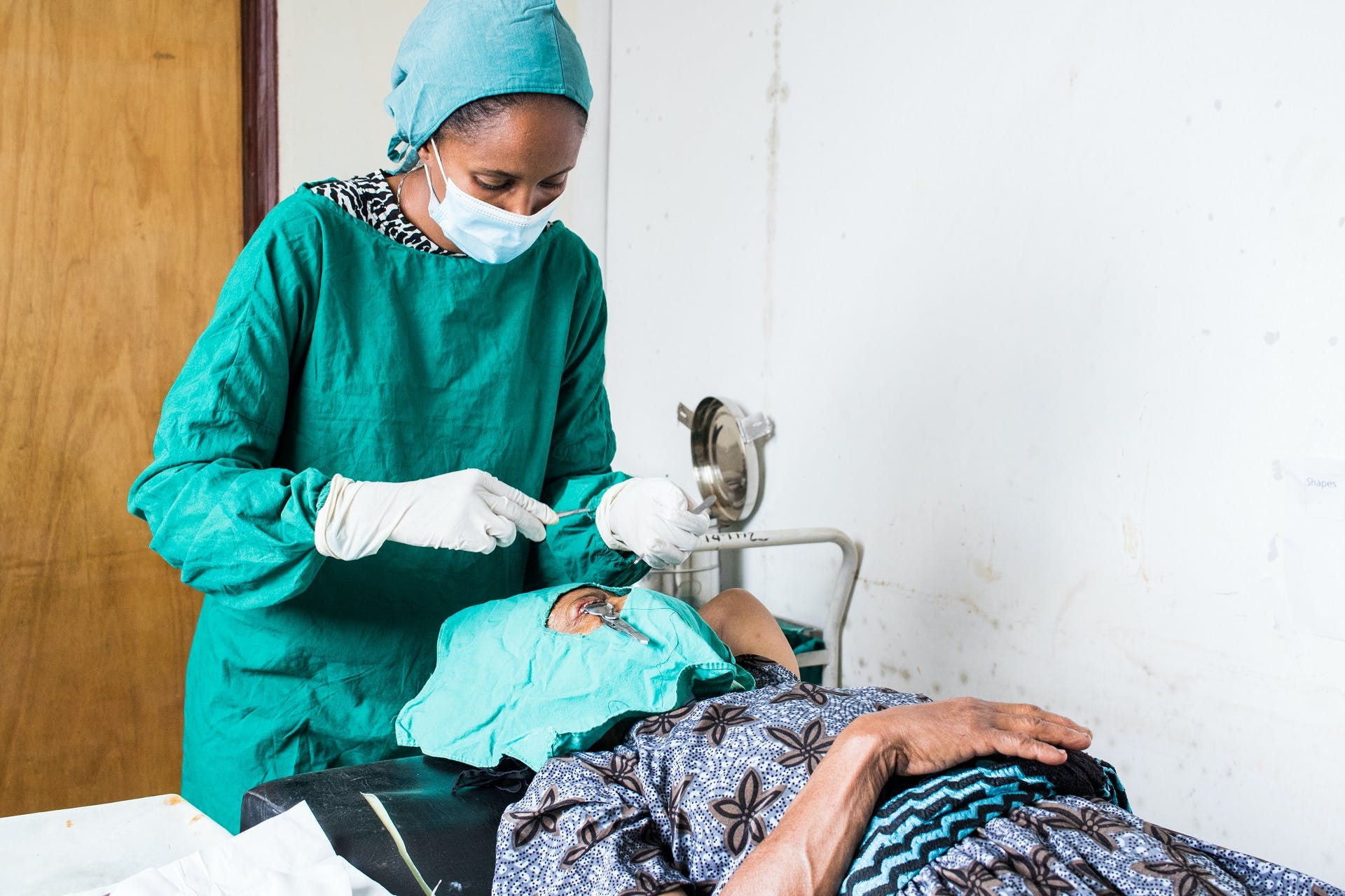 Belay Bonger being treated by an Orbis-trained health worker
