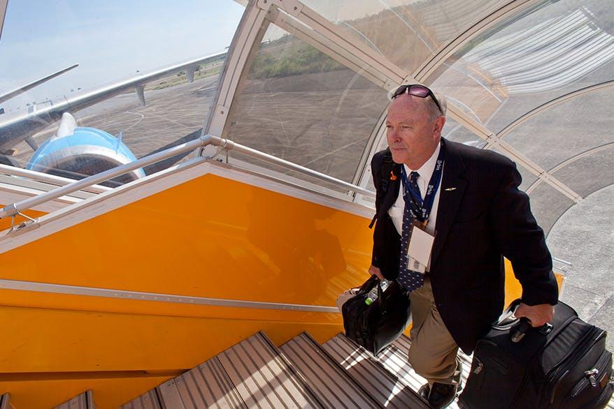 Flying Eye Hospital pilot Captain Gary Dyson boarding the plane