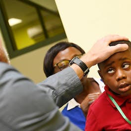 A child has his eyes checked by Orbis Volunteer Faculty aboard the Flying Eye Hospital in Ghana